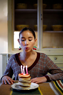 Young girl with pancakes and candles - p1521m2128939 by Charlotte Zobel