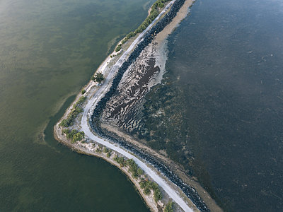 High angle view of dirt road amidst sea - p1166m2112168 by Konstantin Trubavin