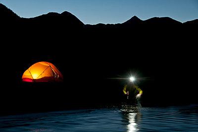Collecting water at dusk. - p1424m1501590 by Braden Gunem