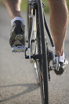 Detail of a cyclist pedaling - p3071132f by Enrico  Calderoni