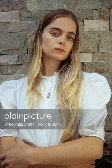Young woman with long blond hair - p1640m2254691 by Holly & John