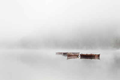 Boats in fog on Lake Braies - p1383m1496366 by Wolfgang Steiner