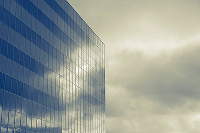 Glass building with cloud refelections - p495m903919 by Jeanene Scott