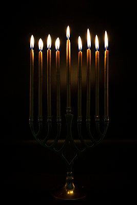 Gold Candles lit in Hanukah Menorah - p1166m2212393 by Cavan Images