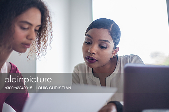 Businesswomen brainstorming during meeting in office - p300m2240015 by LOUIS CHRISTIAN
