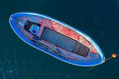 Aerial view of fishing boat in sea - p1596m2206395 by Nikola Spasov