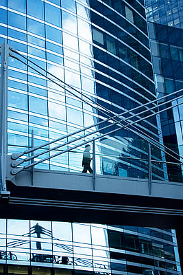 Elevated walkway in front of modern office building - p6751626 by Bruno Veillard