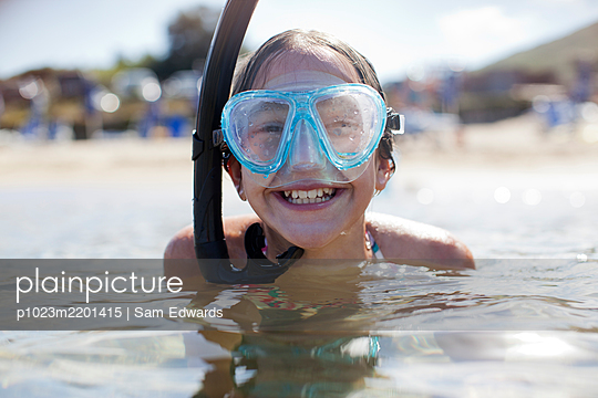 Happy girl wearing snorkel and goggles in ocean - p1023m2201415 by Sam Edwards
