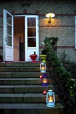 Lit lanterns on steps of Odense home - p349m790844 by Polly Eltes