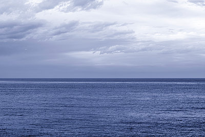 Cloudy November morning over the Pacific Ocean.  - p1436m2135035 by Joseph S. Giacalone
