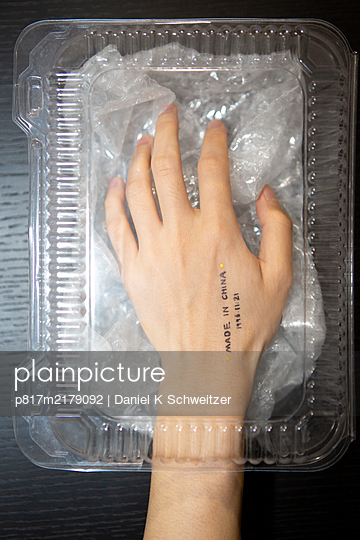 Hand in plastic package - p817m2179092 by Daniel K Schweitzer
