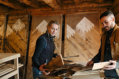 Couple woodworking in workshop - p1192m2093936 by Hero Images