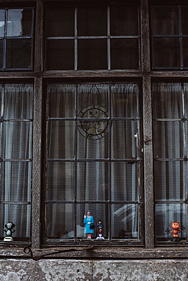 Figurines at the window - p1326m2099782 by kemai