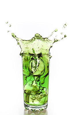 Green liquid imitating flubber from a glass vessel due to an impact with ice. - p1072m957349 by Christopher Sutherland