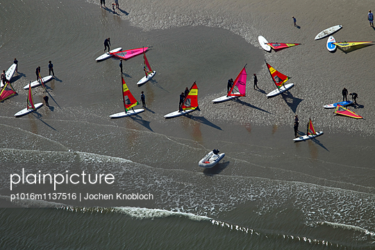 Surfers on the beach - p1016m1137516 by Jochen Knobloch