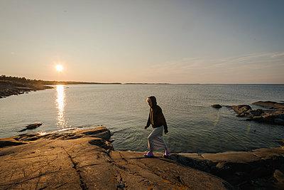 Woman at sunset - p1418m2014910 by Jan Håkan Dahlström