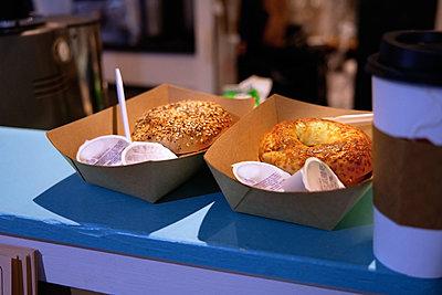 Fresh doughnuts in take out cartons - p300m2273698 by Arman Zhenikeyev