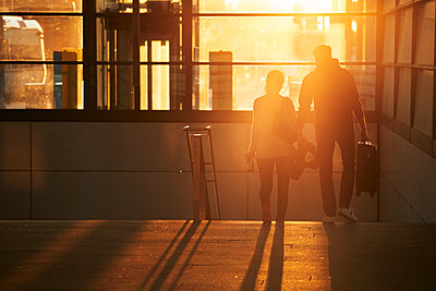 Silhouette of couple walking together - p312m2208226 by Johan Alp