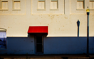 White house and a red roof over the door - p1693m2295457 by Fran Forman