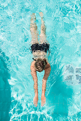 Woman swimming - p312m1063766f by Stefan Isaksson