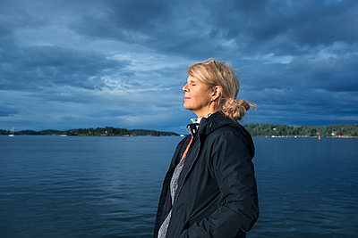 Woman at lake - p312m2101507 by Pernille Tofte