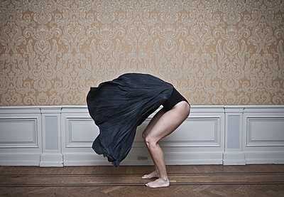 Undressing woman - p1670m2248770 by HANNAH