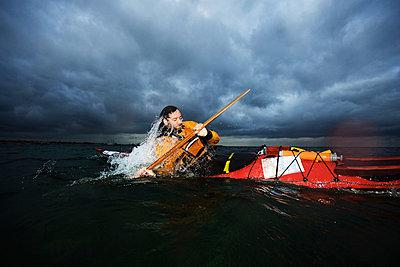 Man in kayak rotating - p42913680f by Soren Hald