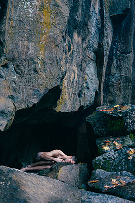 Man Laying Nude in Cave - p1262m1125261 by Maryanne Gobble