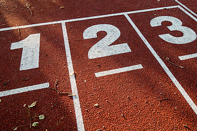 Numbers on track and field lanes  - p1418m1572151 by Jan Håkan Dahlström