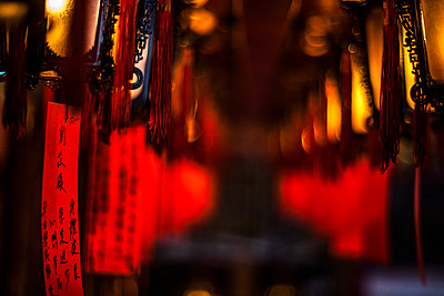 Prayers hang from lanterns at a temple - p343m1090206 by Tim Martin
