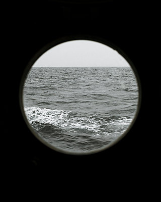 View through porthole to the sea - p1214m2263137 by Janusz Beck
