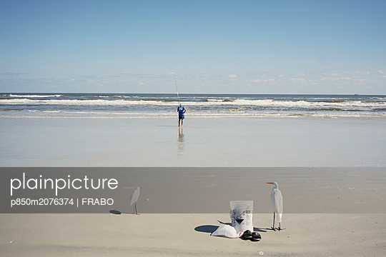 Man fishing on beach - p850m2076374 by FRABO