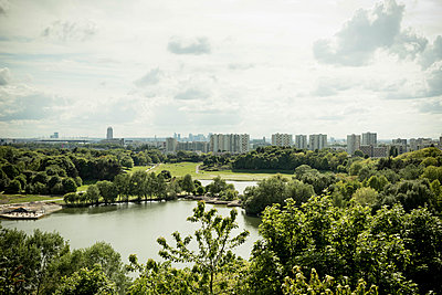 View of park and skyline of Paris - p445m1452437 by Marie Docher