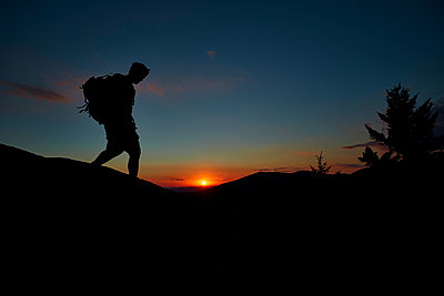 A Man Hiking Along The Appalachian Trail At Sunset - p343m1203850 by Josh Campbell