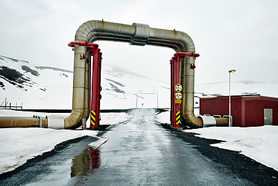 Peculiar pipework built over the road, Krafla Power Station, is the largest Geothermal power station in Iceland, Polar Regions - p871m1082138 by Matt Frost