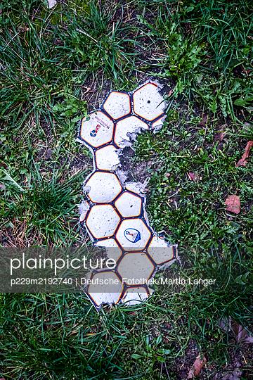 Destroyed soccer ball - p229m2192740 by Martin Langer