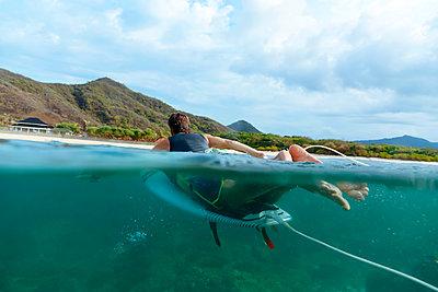 Surfer, Sumbawa island, Indonesia - p300m2156416 by Konstantin Trubavin