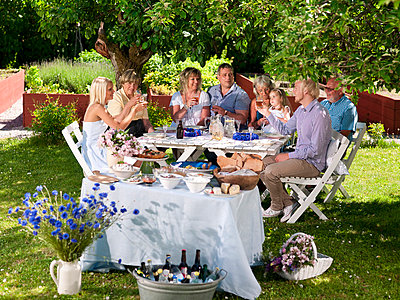 Family having party in garden - p31228721 by Per Magnus Persson