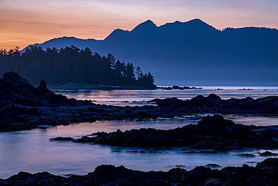 Dusk falls over Vancouver Island viewed from an islet in Nuchatlitz Provincial Park; British Columbia, Canada - p442m2037082 by Ron Watts