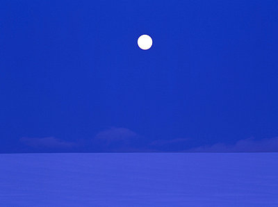 Full moon over snowy land - p5145779f by GYRO PHOTOGRAPHY