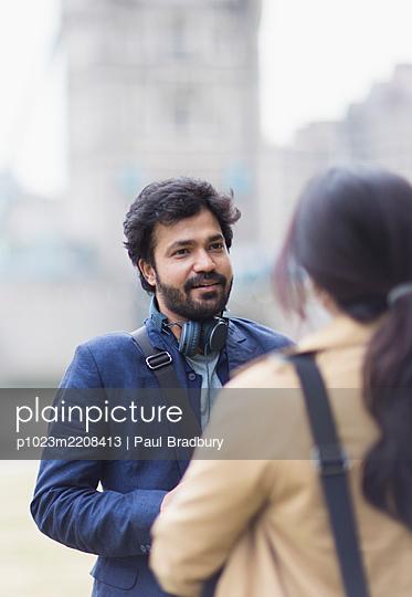 Business people talking outdoors - p1023m2208413 by Paul Bradbury