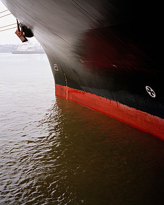 Cropped image of black ship moored on sea - p301m1482557 by Benne Ochs