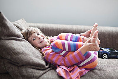 Girl on sofa - p699m1525690 by Sonja Speck