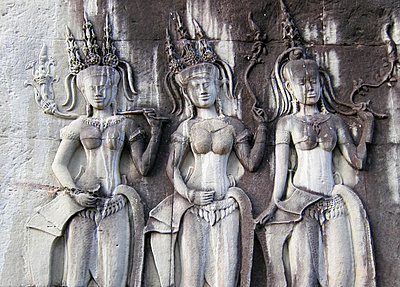 Detail of three bas-relief goddesses on temple wall, Angkor, Siem Reap, Cambodia, Southeast Asia - p934m892967 by Arno Baude photography