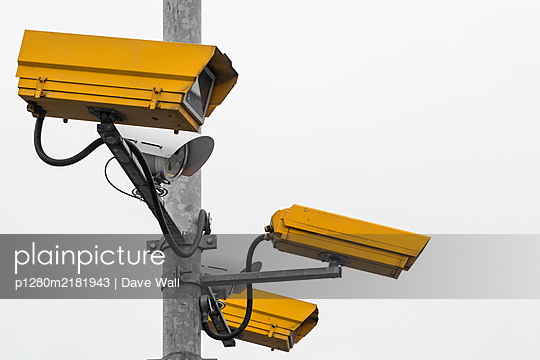 Yellow CCTV Cameras - p1280m2181943 by Dave Wall