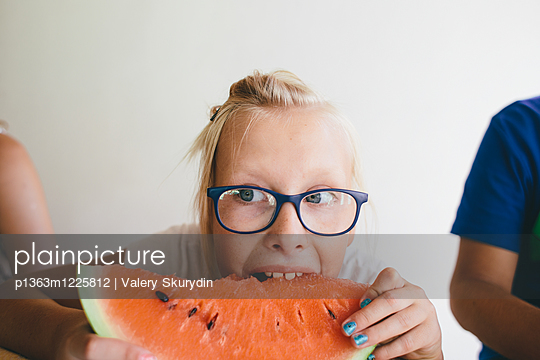 Blond girl is eating a watermelon - p1363m1225812 by Valery Skurydin
