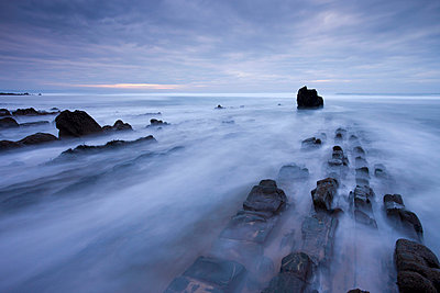 Waves rush over the rocky ledges at Sandymouth Bay in North Cornwall, England, United Kingdom, Europe - p8713008 by Adam Burton