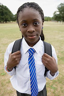 Girl in school uniform - p92410209f by Image Source