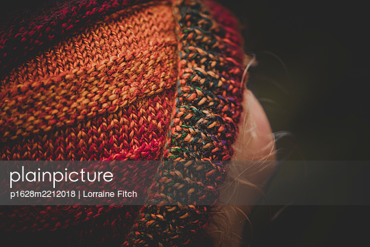 Child in a multicoloured wooly hat - p1628m2212018 by Lorraine Fitch
