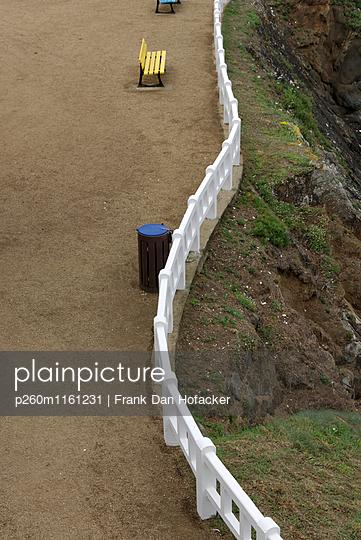 Fence on steep coast - p260m1161231 by Frank Dan Hofacker